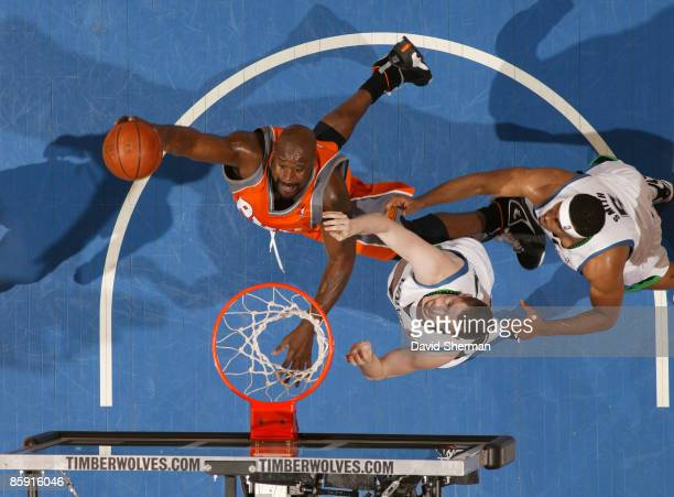 Shaquille O'Neal of the Phoenix Suns dunks against Kevin Love of the Minnesota Timbewolves during the game on April 11 2009 at the Target Center in...