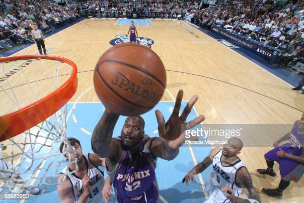 Shaquille O'Neal of the Phoenix Suns goes for the layup against the Utah Jazz at EnergySolutions Arena on March 28, 2009 in Salt Lake City, Utah....
