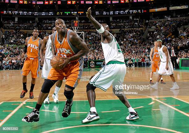 Shaquille O'Neal of the Phoenix Suns goes for the shot against Kevin Garnett of the Boston Celtics on March 26 2008 at the TD Banknorth Garden in...