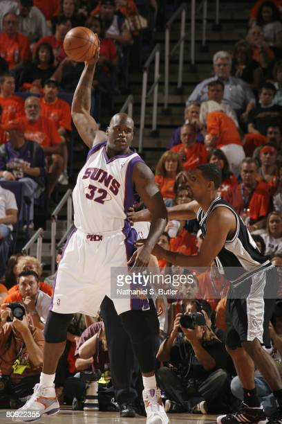 Shaquille O'Neal of the Phoenix Suns looks to move the ball against Kurt Thomas of the San Antonio Spurs in Game Three of the Western Conference...