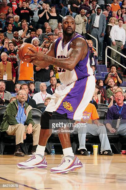 Shaquille O'Neal of the Phoenix Suns moves the ball to the basket during the game against the Denver Nuggets on December 20 2008 at US Airways Center...