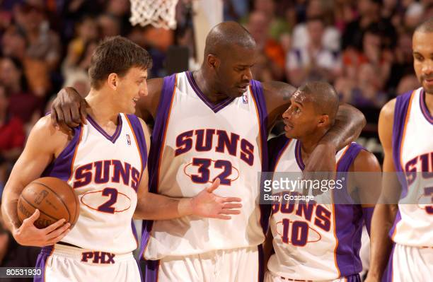 Shaquille O'Neal of the Phoenix Suns talks with teammates Gordan Giricek and Leandro Barbosa as the Suns host the Minnesota Timberwolves in an NBA...