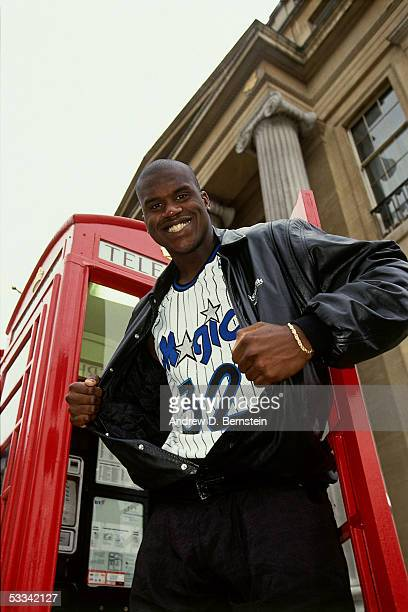 Shaquille O'Neal of the USA Dream Team poses for a portrait in front of a telephone booth during the 1993 Dream Team Tour circa 1993 in London...
