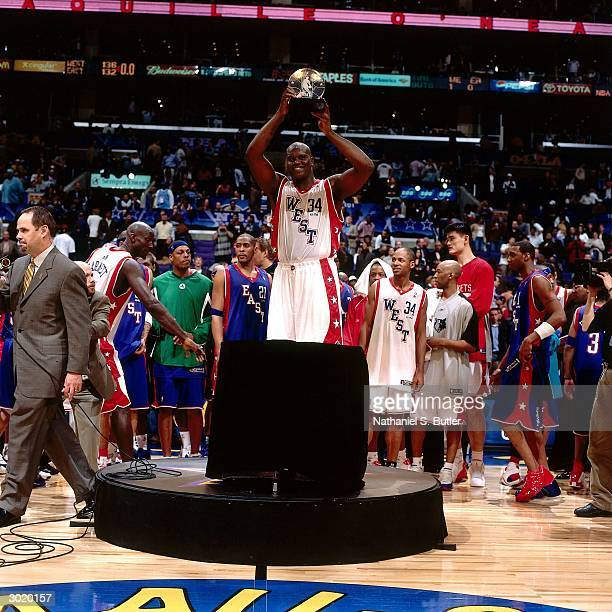 Shaquille O'Neal of the Western Conference AllStars displays his MVP trophy after the 2004 AllStar Game on February 15 2004 at Staples Center in Los...