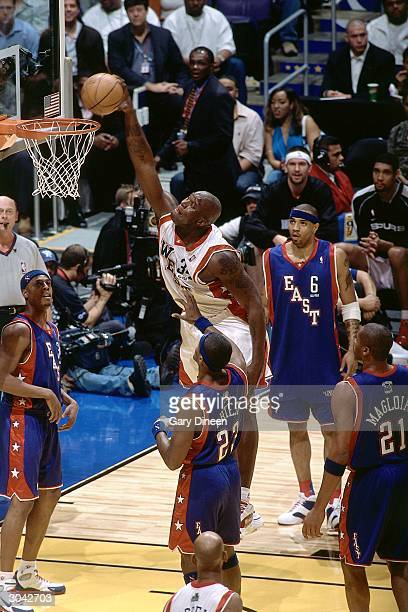 Shaquille O'Neal of the Western Conference AllStars dunks against Ron Artest of the Eastern Conference AllStars during the 2004 AllStar Game on...