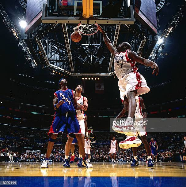 Shaquille O'Neal of the Western Conference AllStars dunks against the Eastern Conference AllStars during the 2004 AllStar Game on February 15 2004 at...