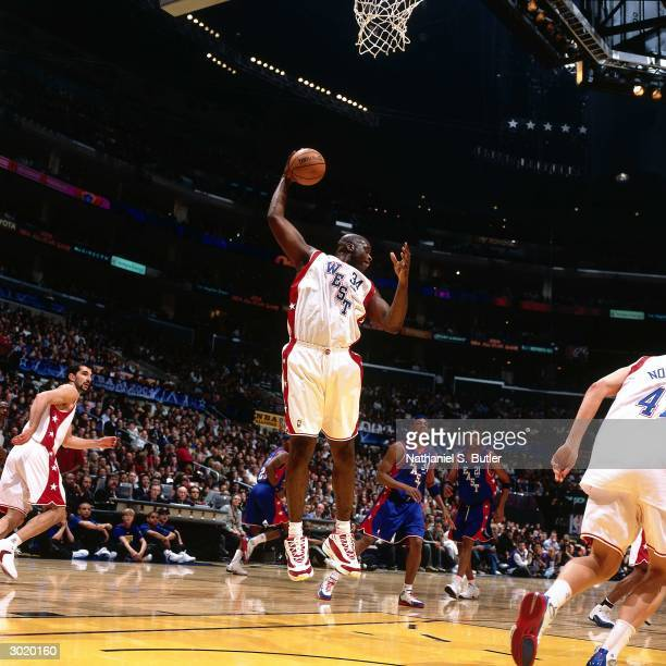 Shaquille O'Neal of the Western Conference AllStars rebounds against the Eastern Conference AllStars during the 2004 AllStar Game on February 15 2004...