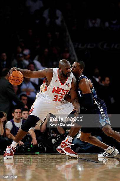 Shaquille O'Neal of the Western Conference goes up against Dwight Howard of the Eastern Conference during the 58th NBA AllStar Game part of 2009 NBA...