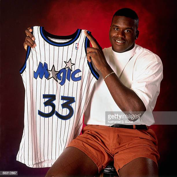 Shaquille O'Neal poses for a portrait with his Magic jersey after being drafted by the Orlando Magic with the first overall pick of the 1992 NBA...