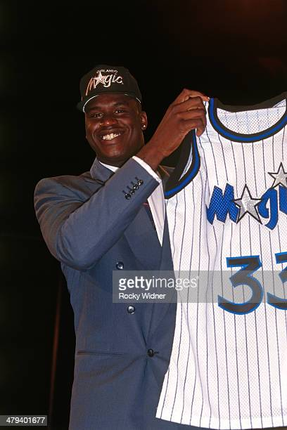 Shaquille Oneal poses with a Magic Jersey after he was selected number one overall by the Orlando Magic during the 1992 NBA Draft as part on June 24...