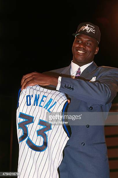 Shaquille O'Neal poses with a Magic jersey after he was selected number one overall by the Orlando Magic during the 1992 NBA Draft as part on June 24...
