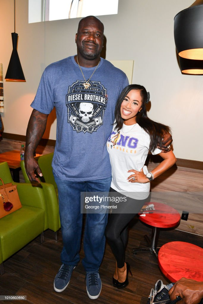 Shaquille O'Neal poses with CP24 weather anchor Patricia Jaggernauth