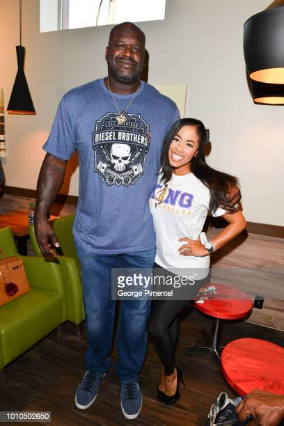 Shaquille O'Neal poses with CP24 weather anchor Patricia Jaggernauth at Krispy Kreme Spadina Ave Location on August 3 2018 in Toronto Canada