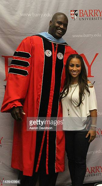 Shaquille O'Neal poses with Nicole Hoopz Alexander as he receives his doctoral degree in education from Barry University at James L Knight Center on...