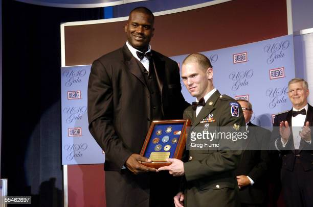 Shaquille O'Neal presents an award to US Army Specialist William T. Groves at the USO Gala honoring General Richard B. Myers on September 14, 2005 at...