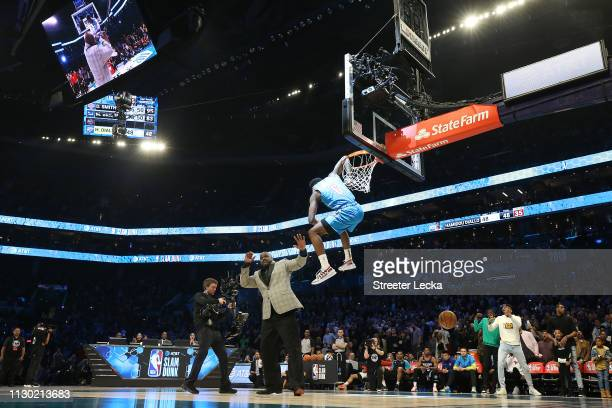 Shaquille O'Neal reacts as Hamidou Diallo of the Oklahoma City Thunder dunks over him during the AT&T Slam Dunk as part of the 2019 NBA All-Star...