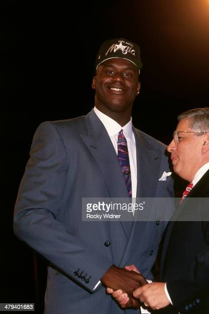 Shaquille O'Neal shakes hands with NBA Commissioner David Stern after he was selected number one overall by the Orlando Magic during the 1992 NBA...