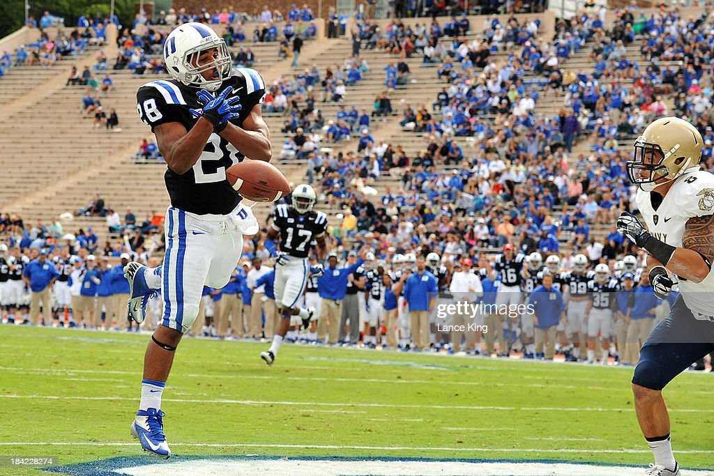 Shaquille Powell #28 of the Duke Blue Devils misses a catch in the end zone against the Navy Midshipmen at Wallace Wade Stadium on October 12, 2013 in Durham, North Carolina. Duke defeated Navy 35-7.