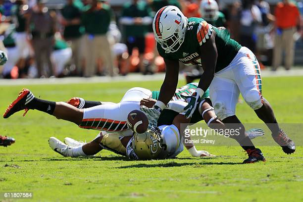 Shaquille Quarterman of the Miami Hurricanes recovers a fumble for a touchdown during the first half against the Georgia Tech Yellow Jackets at Bobby...