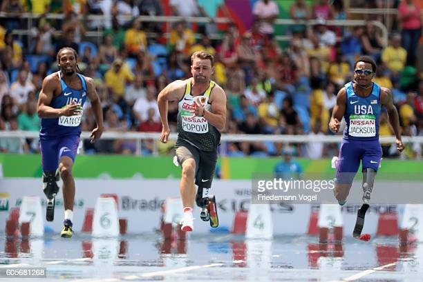 Shaquille Vance of the United States Heinrich Popow of Germany and Desmond Jackson of the United States compete in the Men's 100m T42 on day 7 of the...