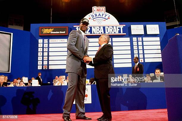 Shaqullle O'Neal shakes hands with NBA Commissioner David Stern after being selected number one overall in the 1992 NBA Draft by the Orlando Magic on...