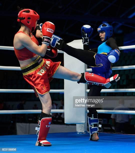 Shara Khamzina of Kazakhstan fights against Nabila Tabit of Marocco during the Invitation Sports Kickboxing Women's K1 60kg Quarterfinals of The...