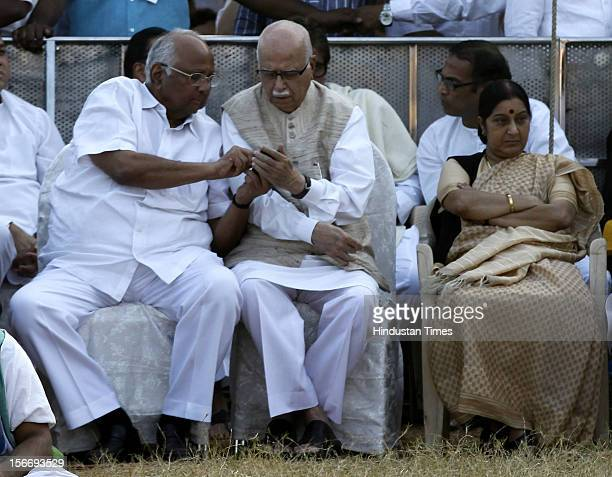 Sharad Pawar Lal Krishna Advani Sushma Swaraj and Chhagan Bhujbal attend Bal Thackeray's funeral at Shivaji Park on November 18 2012 in Mumbai India...