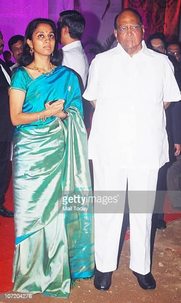 Sharad Pawar with his daughter Supriya Sule during politician Narayan Rane's son's wedding in Mumbai on November 28 2010