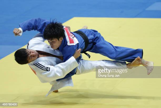 Sharafuddin Lutfillaev of Uzbekistan competes with Toru Shishime of Japan in the Men's 60 kg Bronze medal contest Final at Dowon Gymnasium during the...