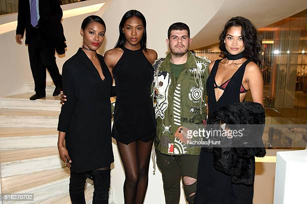 Sharam Diniz Eli Mizrahi and Shanina Shaik attend as Barneys New York celebrates its new downtown flagship in New York City on March 17 2016 in New...