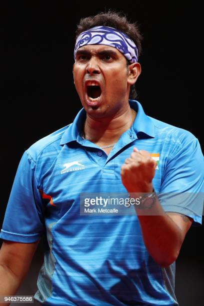 Sharath Achanta of India celebrates winning a point in the Men's Singles Bronze Medal Match against Samuel Walker of England during Table Tennis on...