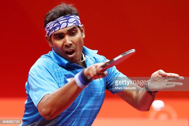 Sharath Achanta of India plays a shot in the Men's Singles Bronze Medal Match against Samuel Walker of England during Table Tennis on day 11 of the...