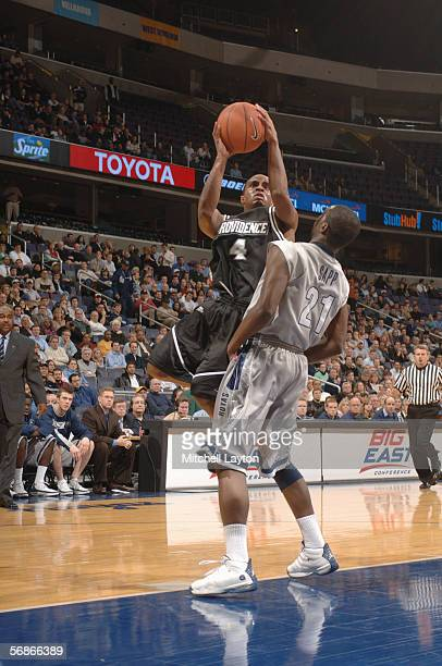 Sharaud Curry of the Providence Friars goes to the basket against Jessie Sapp of the Georgetown Hoyas on January 5 2006 at MCI Center in Washington...