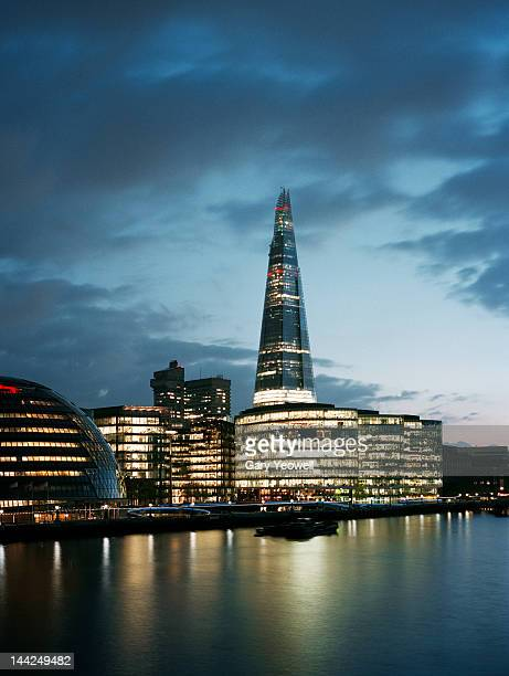 shard and city hall across river thames at dusk - yeowell stock photos and pictures