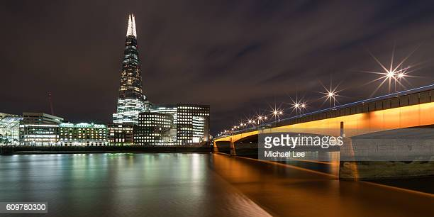 Shard and London Bridge at Night - London, England