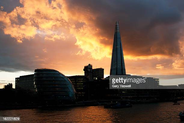 shard and south bank of river thames at sunset - yeowell stock pictures, royalty-free photos & images