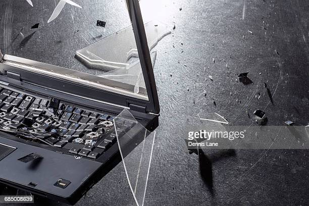 Shards from shattering laptop