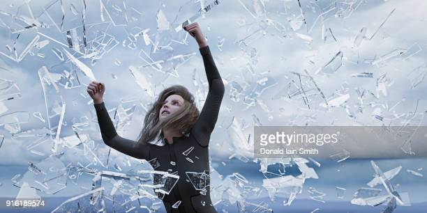 shards of glass falling on woman - exploding glass stock photos and pictures