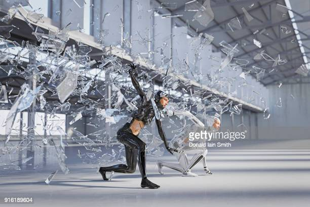 Shards of glass surrounding futuristic woman and android