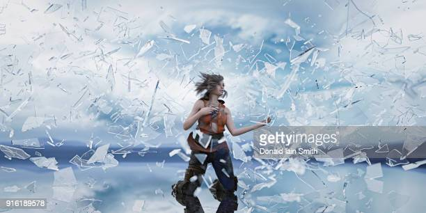 shards of glass surrounding kneeling woman - exploding glass stock photos and pictures