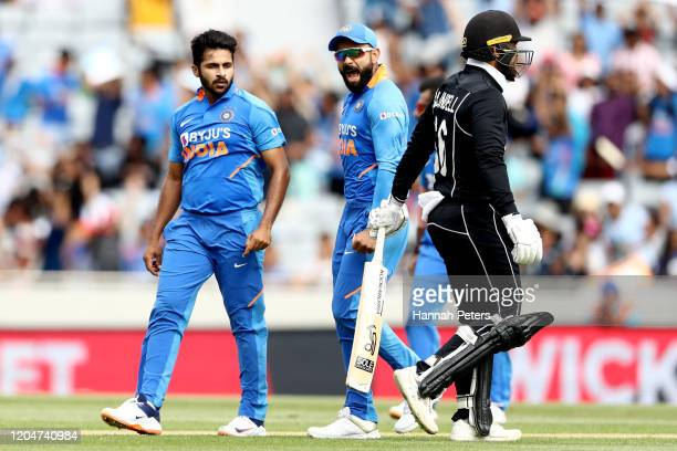 Shardul Thakur and Virat Kohli of India celebrate the wicket of Tom Blundell of the Black Caps during game two of the One Day International Series...