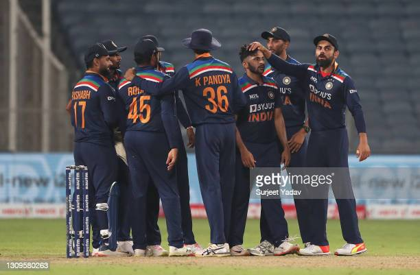 Shardul Thakur of India celebrates after taking the wicket of Dawid Malan of England with team mate Virat Kohli during the 3rd One Day International...