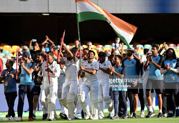 Shardul Thakur of India celebrates victory with his team mates after day five of the 4th Test Match in the series between Australia and India at The...