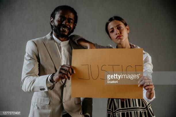 share justice to the world - supreme court justice stock pictures, royalty-free photos & images