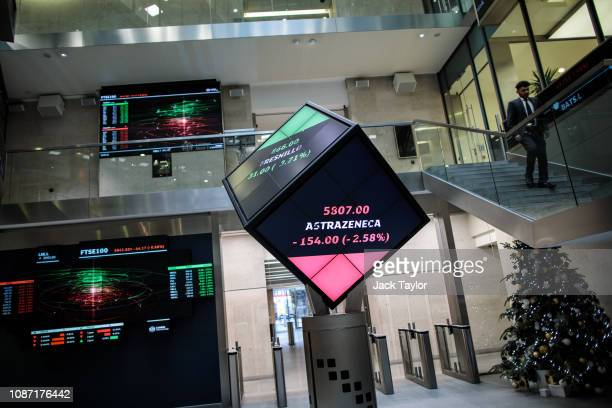 Share price information is displayed on screens at the London Stock Exchange offices after reopening following the Christmas holiday on December 27...