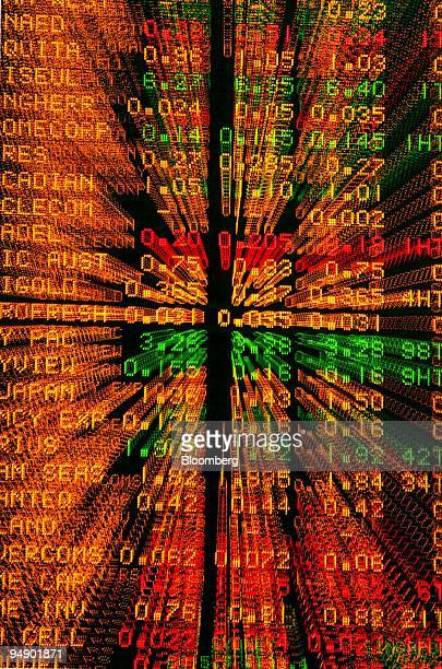 Share prices are displayed on the stock boards at the Australian Securities Exchange in this photo illustration taken in Sydney Australia on Monday...
