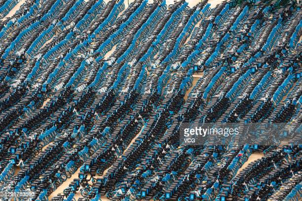Shared electric bikes are lined up at a recycling depot near Changsha South Railway Station on December 17, 2020 in Changsha, Hunan Province of China.