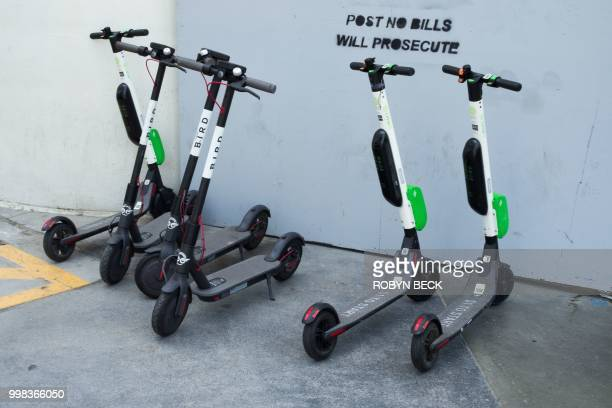 Shared electric scooters are seen in Santa Monica California on July 13 2018 Cities across the US are grappling with the growing trend of electric...
