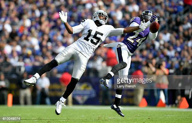Shareece Wright of the Baltimore Ravens breaks up a pass intended for Michael Crabtree of the Oakland Raiders in the fourth quarter at MT Bank...