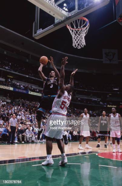Shareef Abdur-Rahim, Center and Power Forward for the Vancouver Grizzlies attempts a one handed lay up shot to the basket over Rodney Rogers of the...